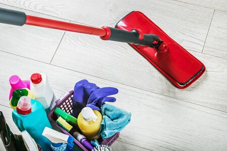 Photo pour different products and items for cleaning on the floor in the room. Concept cleaning - image libre de droit