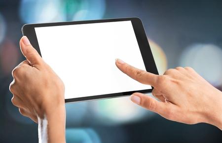 Photo pour Holding, hand, tablet. - image libre de droit