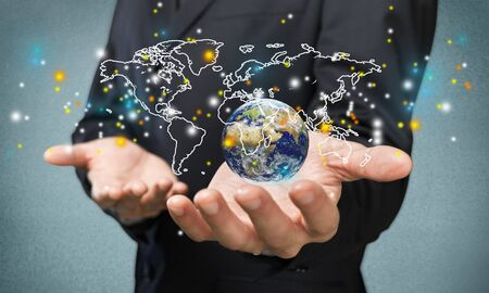 Business man hand touching icons with world map
