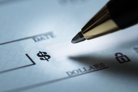 Photo pour Writing a check - image libre de droit