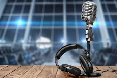 Photo for Retro microphone and headphones on table - Royalty Free Image