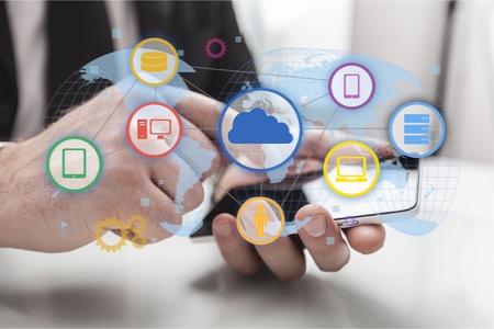 Foto de business man hand working on digital tablet computer and smart phone with digital layer business strategy and social media diagram on wooden desk - Imagen libre de derechos