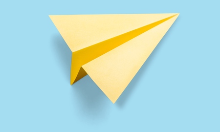Foto de Yellow paper plane - Imagen libre de derechos