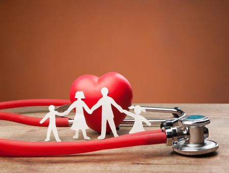 Photo for Family Cut-out  Medical Insurance Concept - Royalty Free Image
