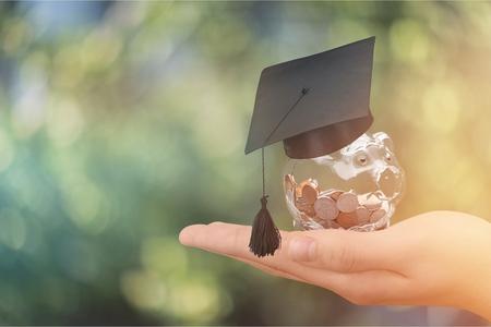 Photo pour Hand holding coins in glass - image libre de droit