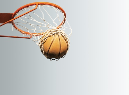 Basketball performs a slam dunk