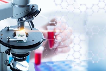Photo pour Microscope with lab glassware science laboratory research - image libre de droit