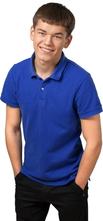 Teenage male standing with his hands in his pockets