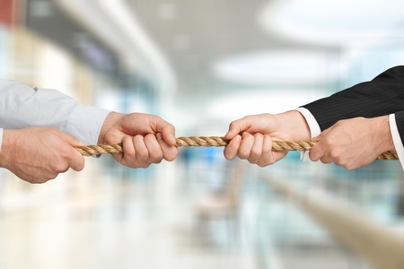 Business men hands holding rope