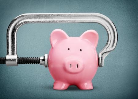 Photo pour Pink piggy bank and clamp on background - image libre de droit