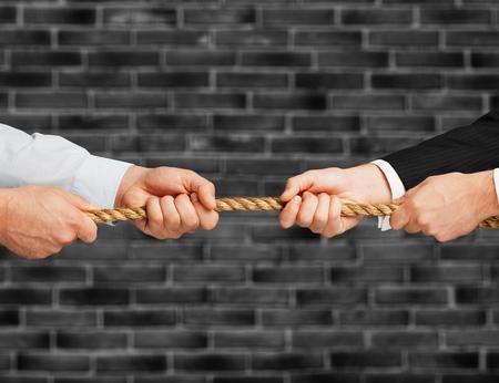 Business men hands holding rope