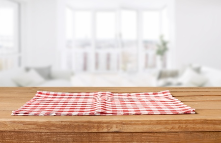 Photo pour Red cloth napkin on wooden background - image libre de droit