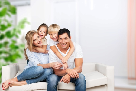 Foto für Beautiful smiling family sitting at sofa at home - Lizenzfreies Bild