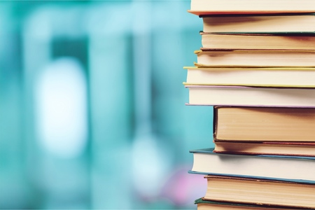 Photo pour Stack of colorful books on blurred background - image libre de droit