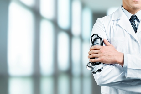 Young man doctor holding stethoscope