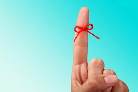 Photo pour Rope bow on finger pointing - image libre de droit