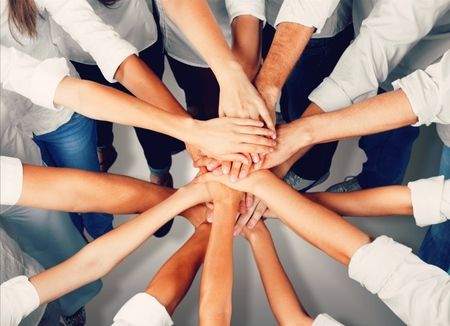 Photo pour Group of people stacking hands together - image libre de droit
