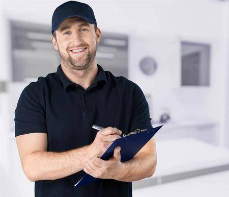 Photo pour Portrait of cheerful Handsome  mechanic  on background - image libre de droit
