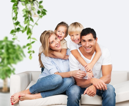 Photo for Beautiful smiling family on background - Royalty Free Image