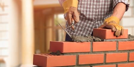 Foto de Masonry build bricklayer construction handyman layer trowel - Imagen libre de derechos