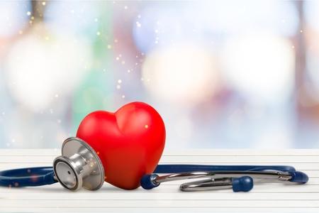 Photo pour Red heart and a stethoscope on backgrouund - image libre de droit