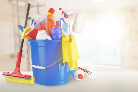 Photo pour Plastic bottles, cleaning  gloves and bucket on white background - image libre de droit