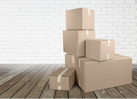 Photo for Different cardboard boxes in room - Royalty Free Image