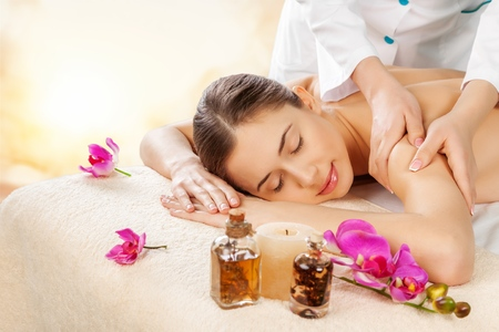 Photo for Masseur doing massage on woman body in - Royalty Free Image