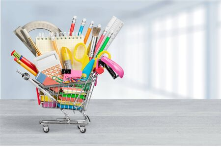 Photo for Stationery objects in mini supermarket cart on - Royalty Free Image