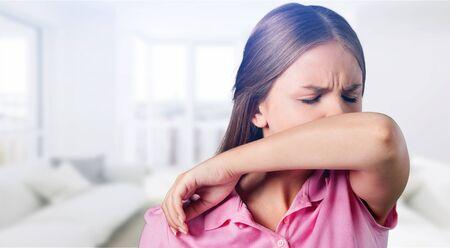 Photo pour Young woman scratching her nose - image libre de droit