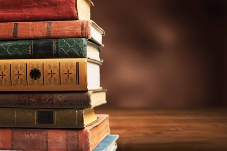 Photo for Collection of old books on wooden desk - Royalty Free Image