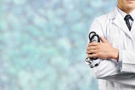 Photo pour Portrait of doctor with arms crossed - image libre de droit