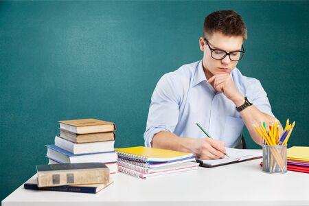 Photo pour Young teacher working in school classroom - image libre de droit