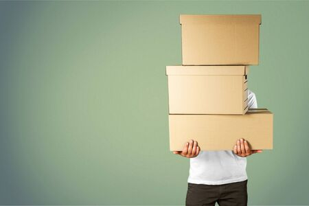 Photo for Man with cardboard boxes on background - Royalty Free Image