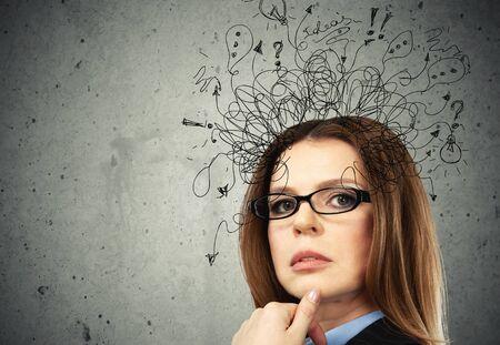 Foto de Thoughtful stressed young man with a mess - Imagen libre de derechos