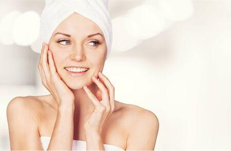 Photo pour Portrait of beautiful young woman  in white towel on head on background - image libre de droit