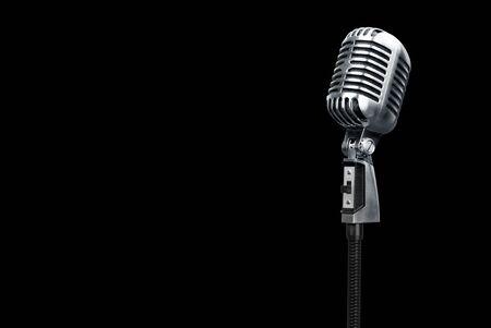 Photo pour Retro style microphone on black - image libre de droit