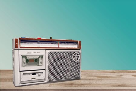 Photo for Old radio on table in front of green background. Vintage style photo - Royalty Free Image