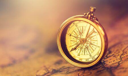 Foto de Old gold compass on ancient map background ,vintage tone with copy space for text. - Imagen libre de derechos