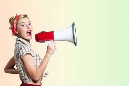 Photo for Portrait of woman holding megaphone, dressed in pin-up style - Royalty Free Image