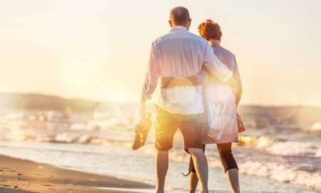 Photo for Close-up portrait of an elderly couple hugging on seacoast - Royalty Free Image