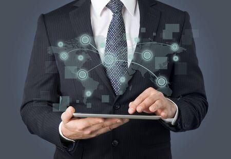 Photo pour usinessmen, hand touch screen graph on a tablet - image libre de droit