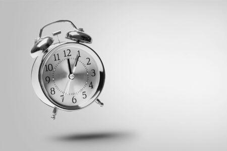 Foto de Red alarm clock flying or jumping - Imagen libre de derechos
