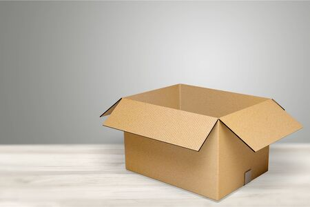 Photo for Cardboard box on desk - Royalty Free Image