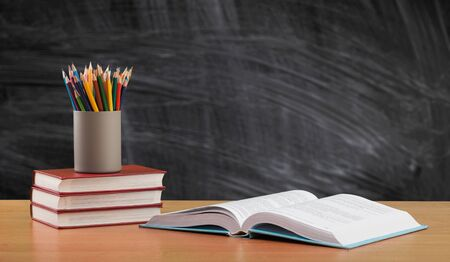 Photo pour Back to school background with books and blackboard - image libre de droit
