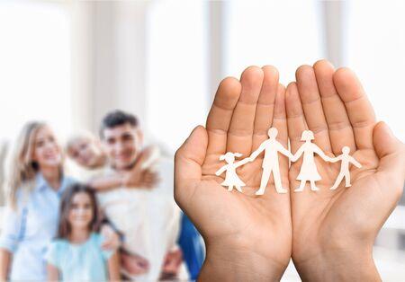 Photo pour Hands with family made of paper - image libre de droit