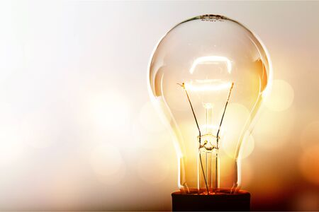 Photo for Glowing glass light bulb on background - Royalty Free Image