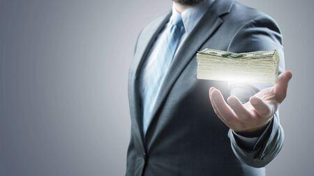 Businessman holding cash
