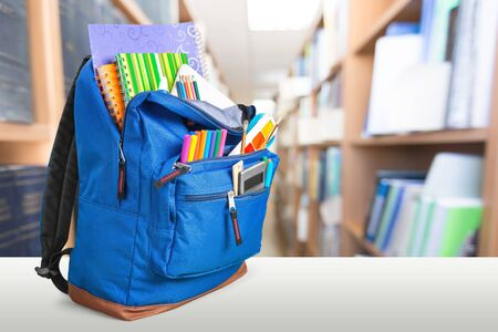 Photo pour School Backpack with stationery on wooden table - image libre de droit