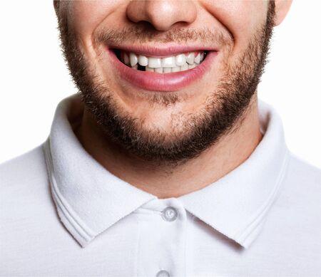 Foto de Portrait of handsome young man with toothy - Imagen libre de derechos
